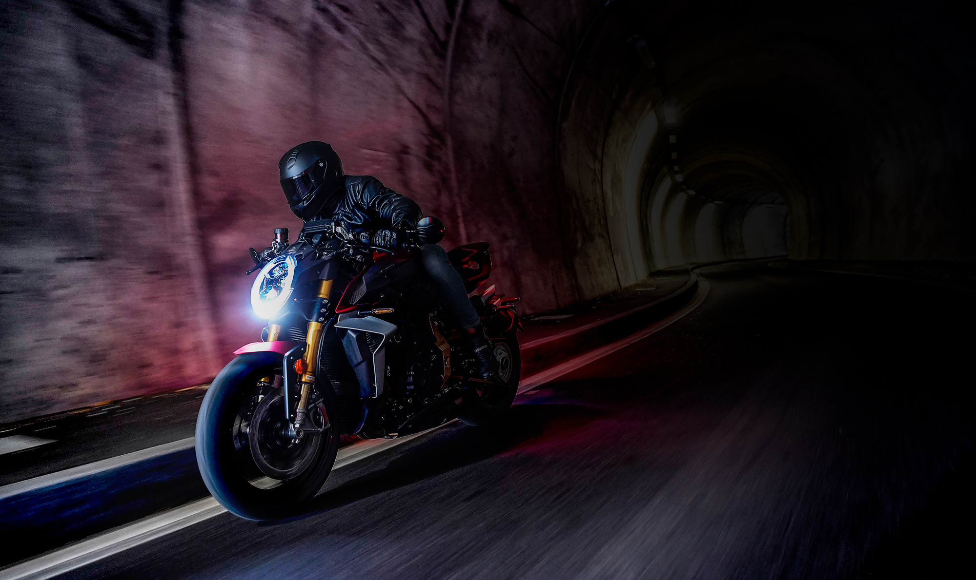 mv agusta brutale 1000 motorcycle riding through a dark tunnel