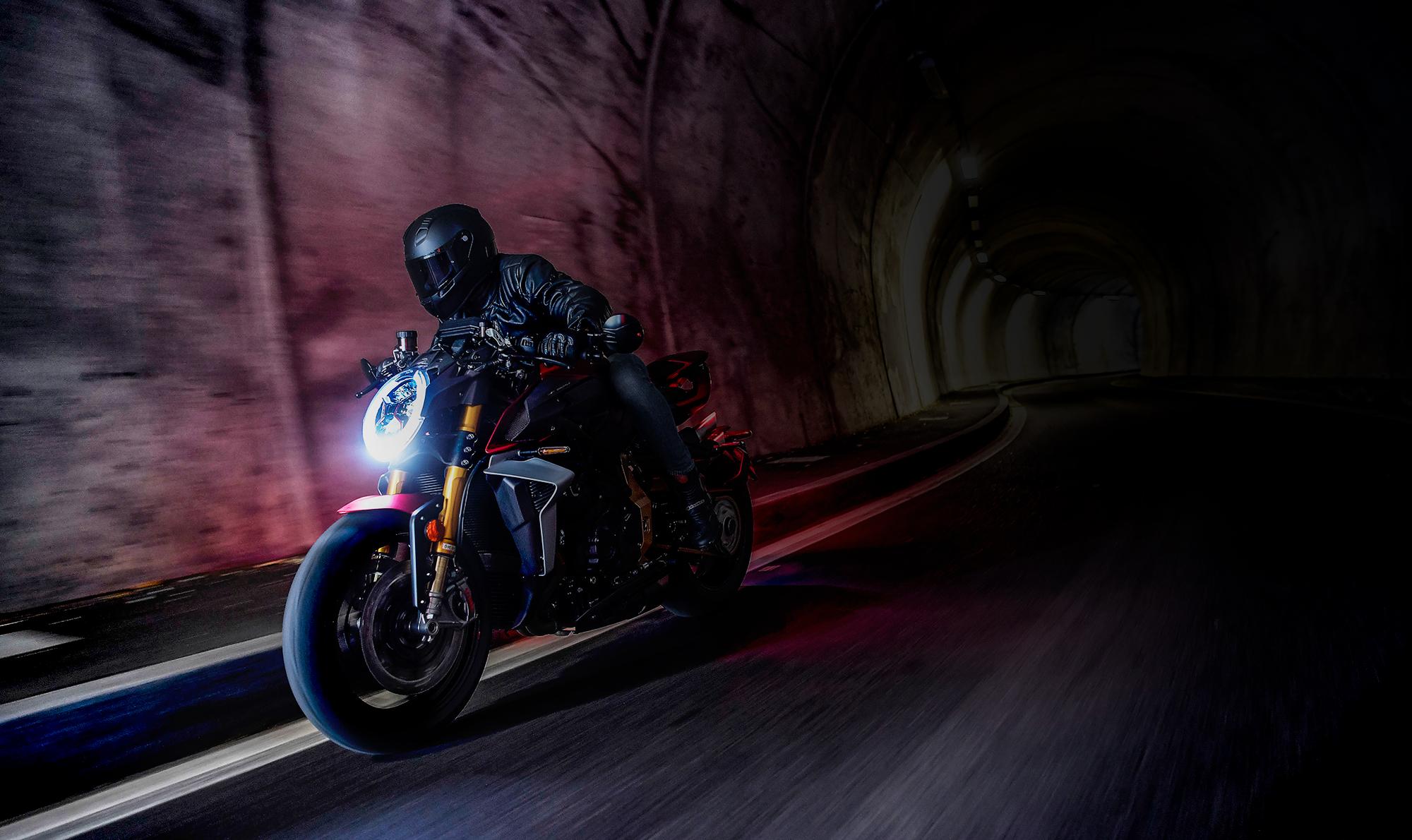 mv agusta brutale 1000 motorcycle riding through a dark tunnel