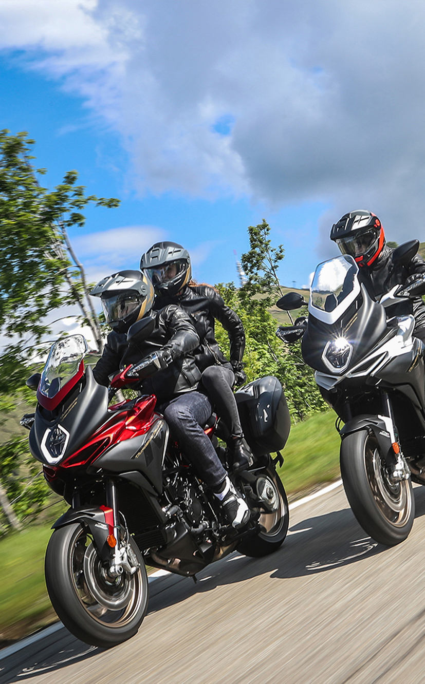 two mv agusta turismo veloce lusso motorcycles riding with three riders for mobile devices