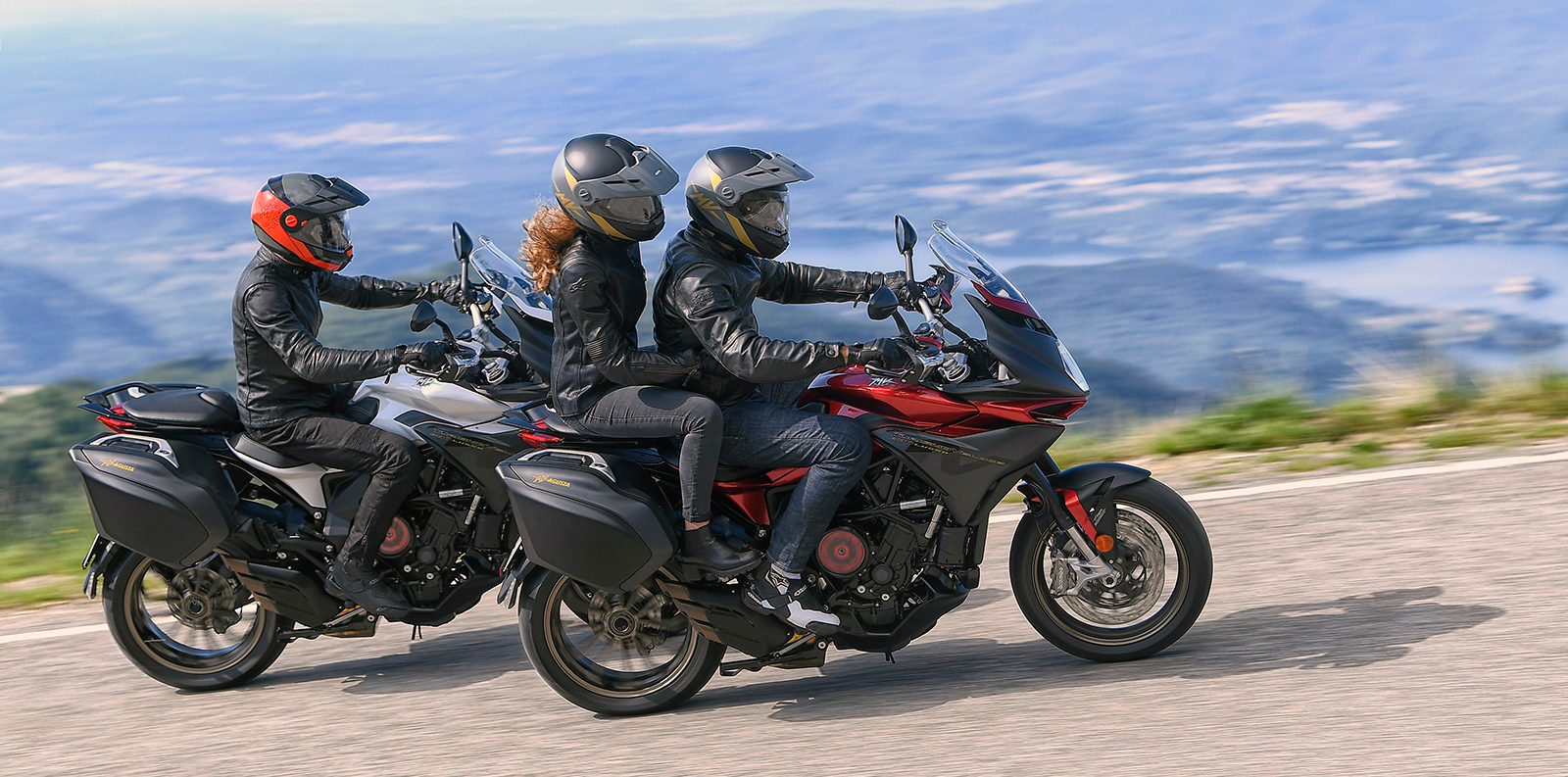 two mv agusta turismo veloce lusso motorcycles riding with three riders